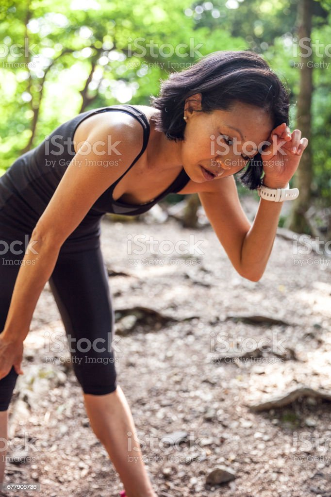 Japanese woman running in the forest royalty-free stock photo