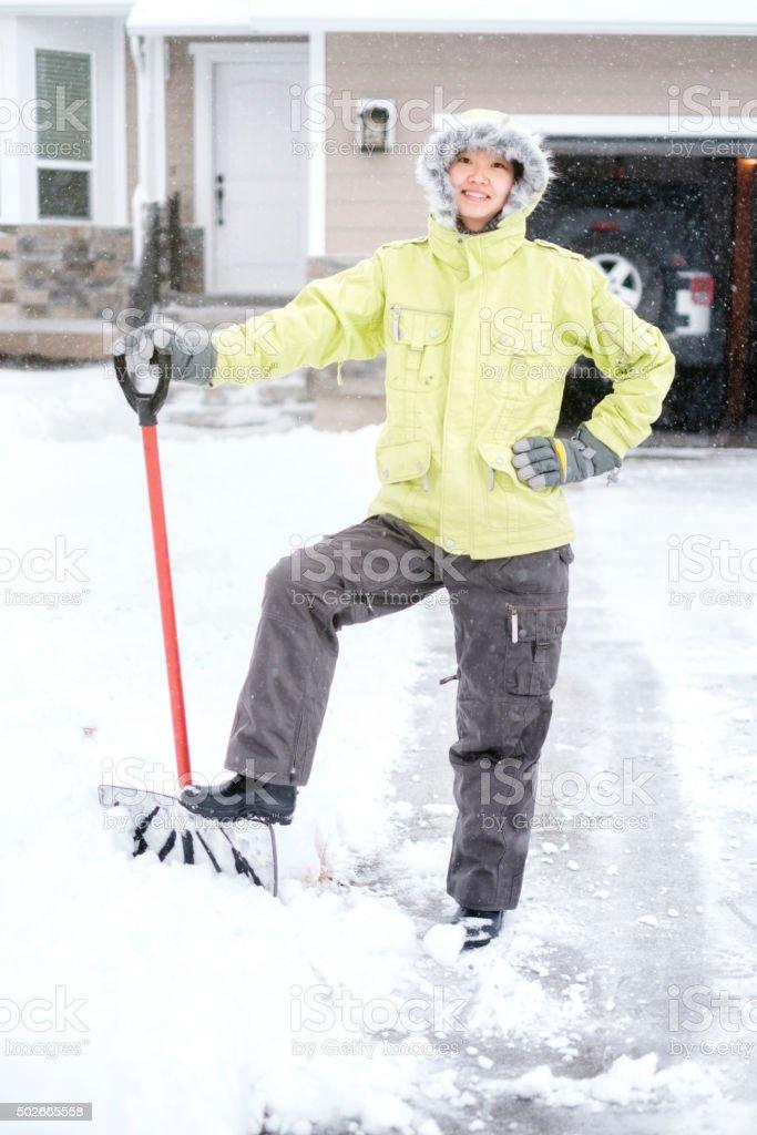 Japanese Woman Shoveling Snow stock photo