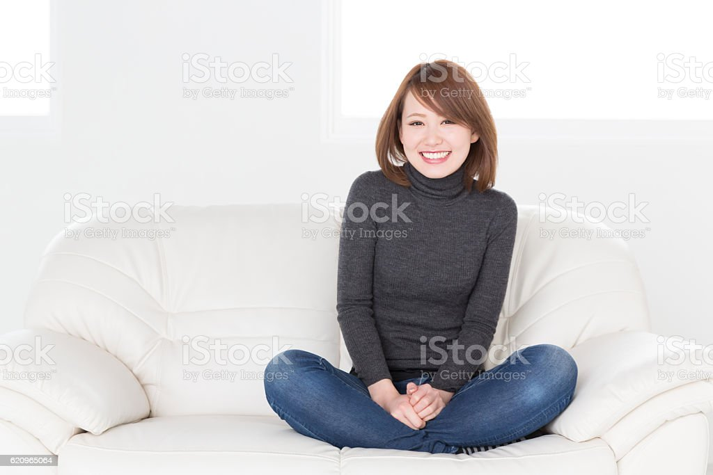 Japanese woman sitting on a sofa stock photo