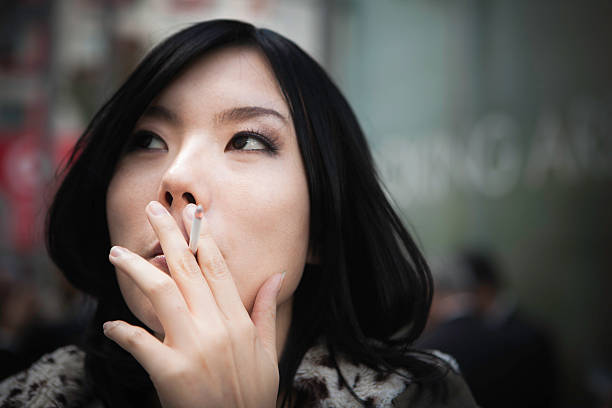 Japanese woman smoking stock photo