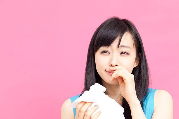 japanese woman sneezing - くしゃみ 日本人 ストックフォトと画像