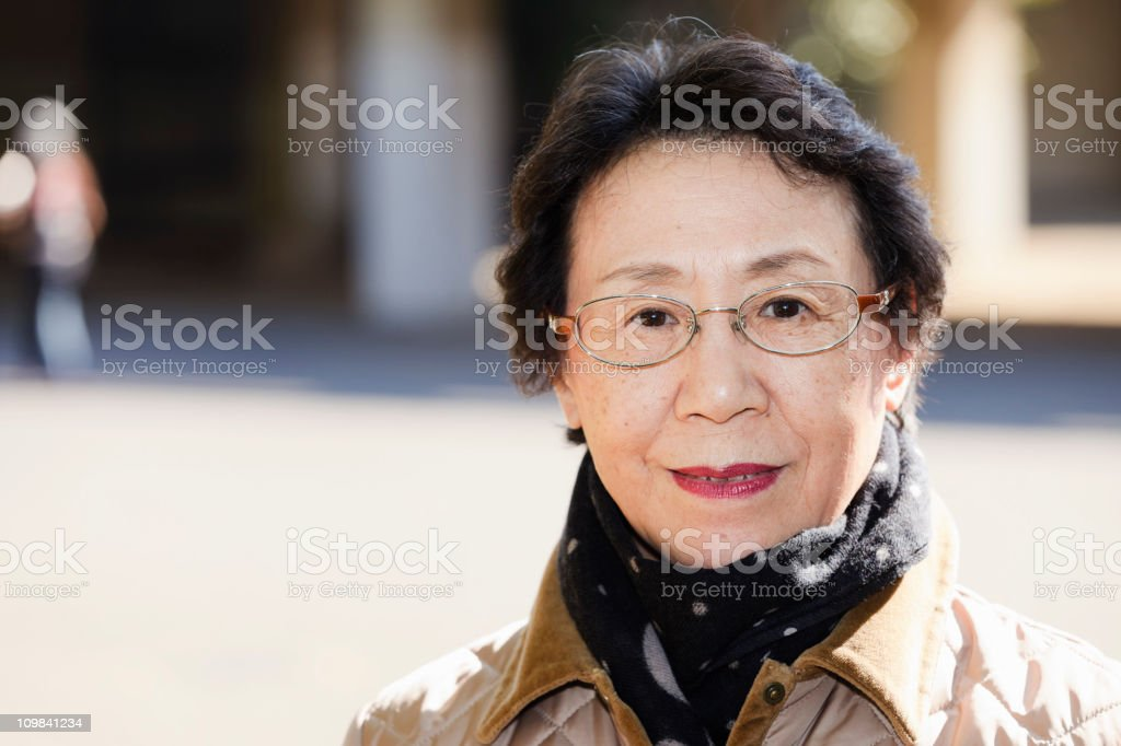 Japanese Woman Standing Downtown stock photo