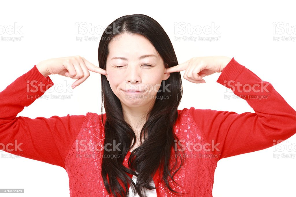 Japanese woman suffers from noise stock photo