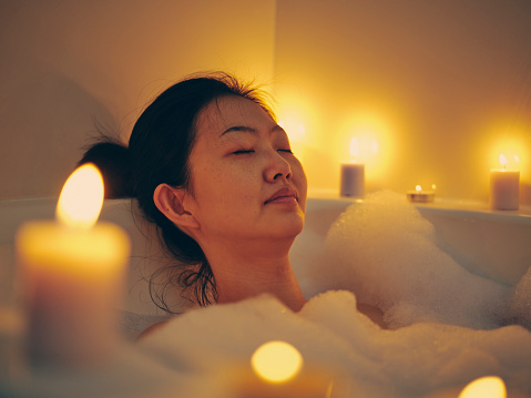 Japanese Woman Taking A Candlelight Bath Stock Photo - Download Image Now