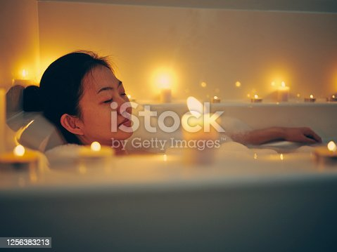 istock Japanese Woman Taking a Candlelight Bath 1256383213