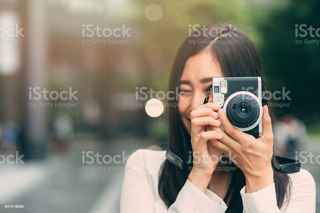 Japanese woman taking a picture stock photo