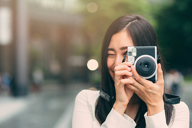 Japanese woman taking a picture ストックフォト