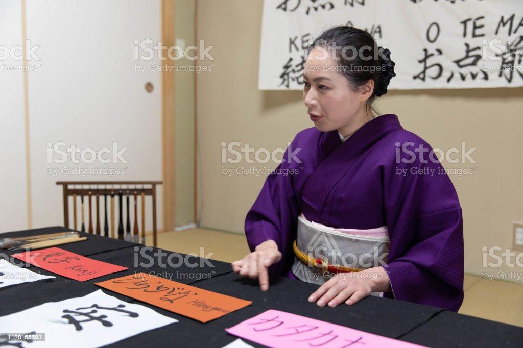 Japanese woman teaching Japanese culture