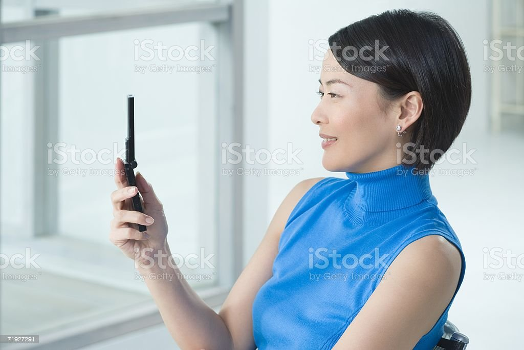 Japanese woman text messaging royalty-free stock photo