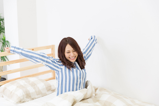 Japanese Woman Waking Up Stock Photo - Download Image Now