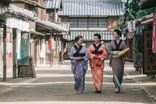 Japanese woman in traditional kimonos, walking in Edo period town