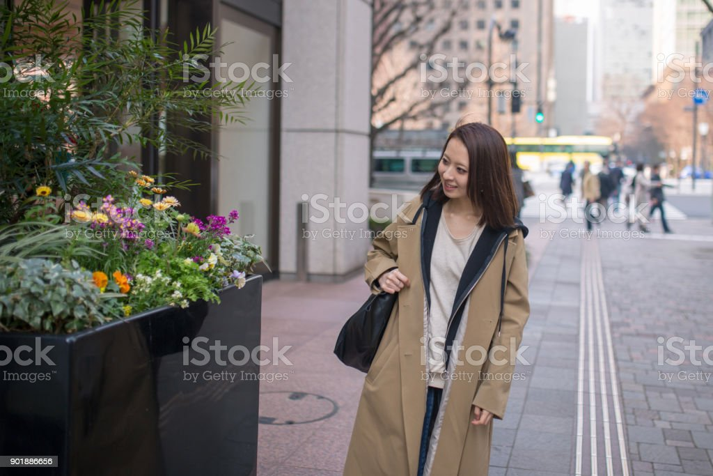 Japanese woman walking in urban city stock photo