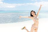 Japanese woman wearing bikini on the beach