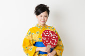 Japanese woman wearing yukata in white background