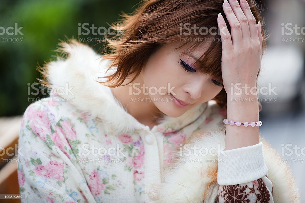 Japanese woman with a headache royalty-free stock photo