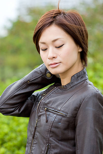 Japanese woman with eyes closed stock photo