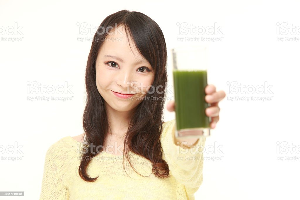 Japanese woman with green vegetable juice stock photo