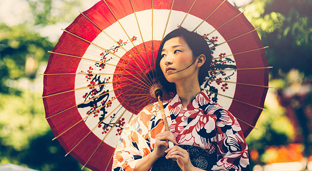 japanese woman with oil paper umbrella - geisha girl stock photos and pictures