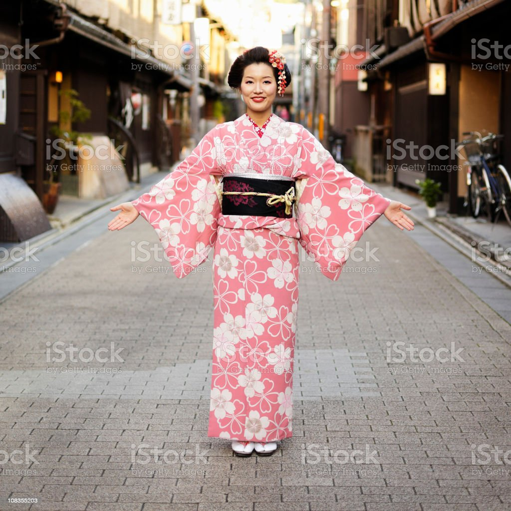 Japanese Woman With Open Arms royalty-free stock photo
