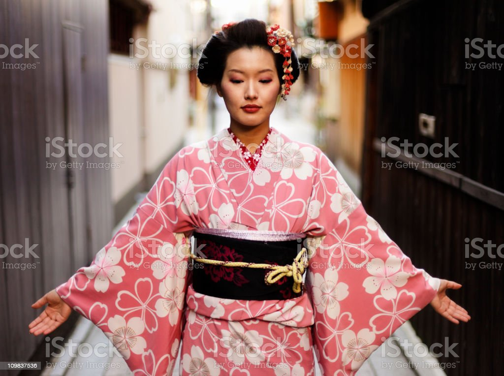 Japanese Woman With Open Arms stock photo