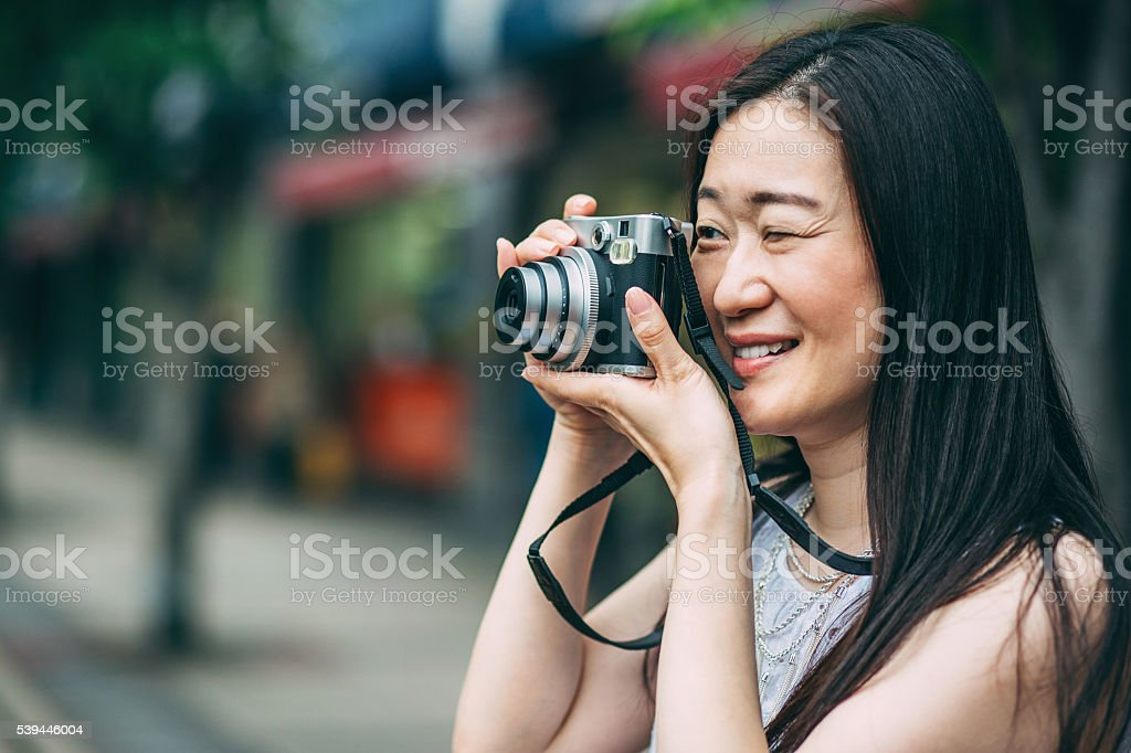 Japanese woman with photo camera stock photo