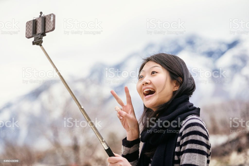 Japanese Woman with Selfie Stick stock photo