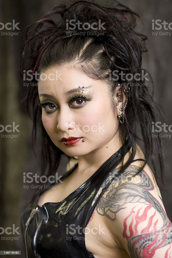 Japanese woman with tattoos and piercings royalty-free stock photo