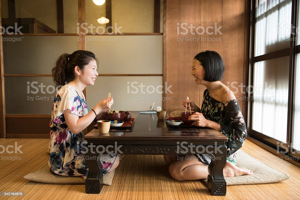 Japanese Women At Table In Traditional Restaurant Stock
