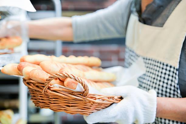 japanese women baker working in the bakery - パン屋 ストックフォトと画像