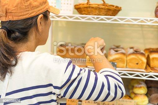 628876250istockphoto Japanese women baker working in the bakery 608558524