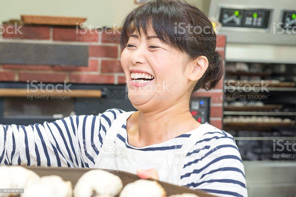 Japanese women baker working in the bakery stock photo