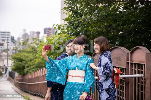 Japanese women in yukata taking selfie picture on slope