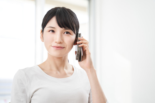 Japanese women making calls on their smart phones