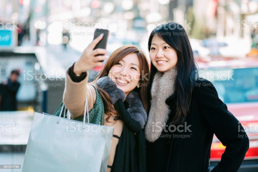 Japanese Women taking Ginza Selfie royalty-free stock photo
