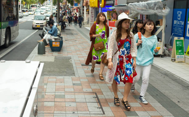 Japanese women wearing colorful dresses. stock photo
