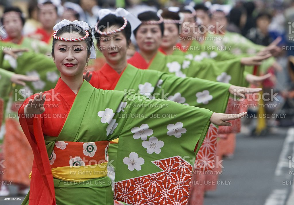 Japanese women wearing kimono dancing in line at a festival royalty-free stock photo