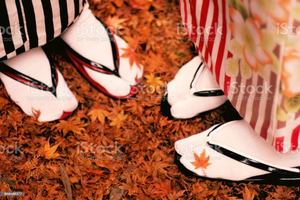 Japanese women's foot in kimono stock photo