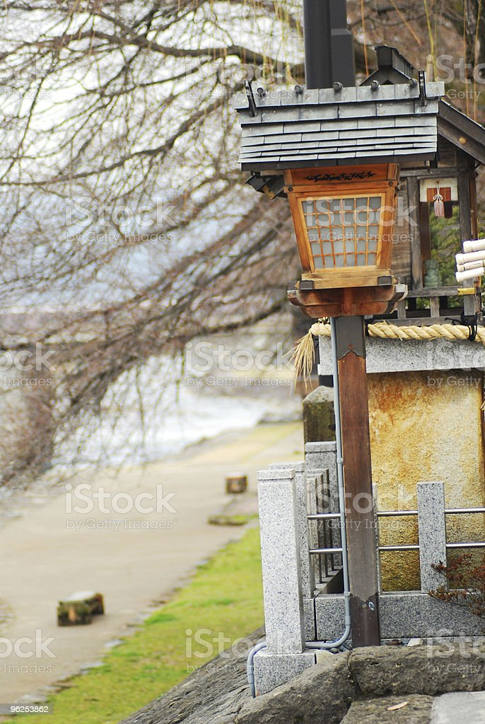 Japanese wood lantern by the river stock photo