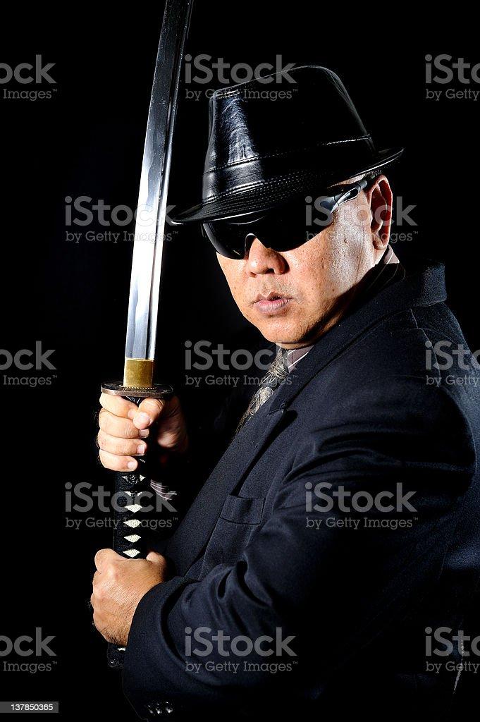 Japanese Yakuza with samurai sword stock photo