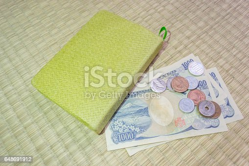 istock Japanese yen notes. Currency of Japan and green notebook 648691912
