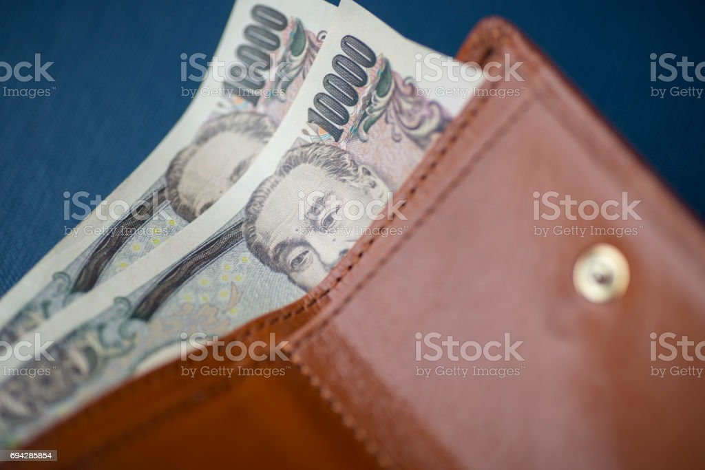 10000 Japanese Yen notes in a wallet stock photo