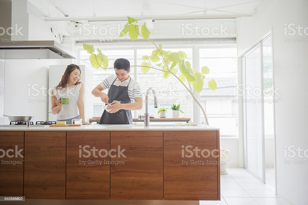 Japanese young couple cooking on holiday stock photo