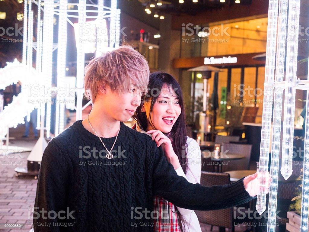 Japanese young couple watching the Christmas illumination. stock photo