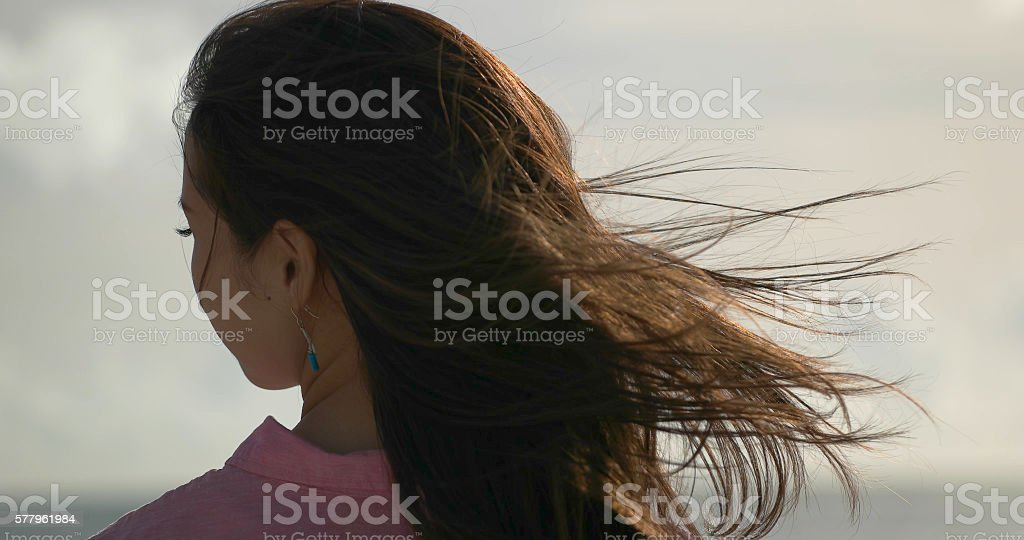 Japanese young female looking ocean. stock photo
