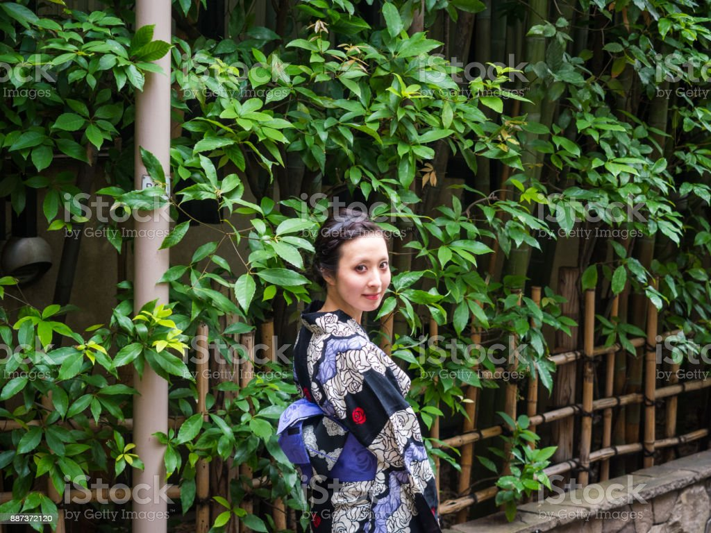 Japanese young Kimono woman walking on the street. stock photo