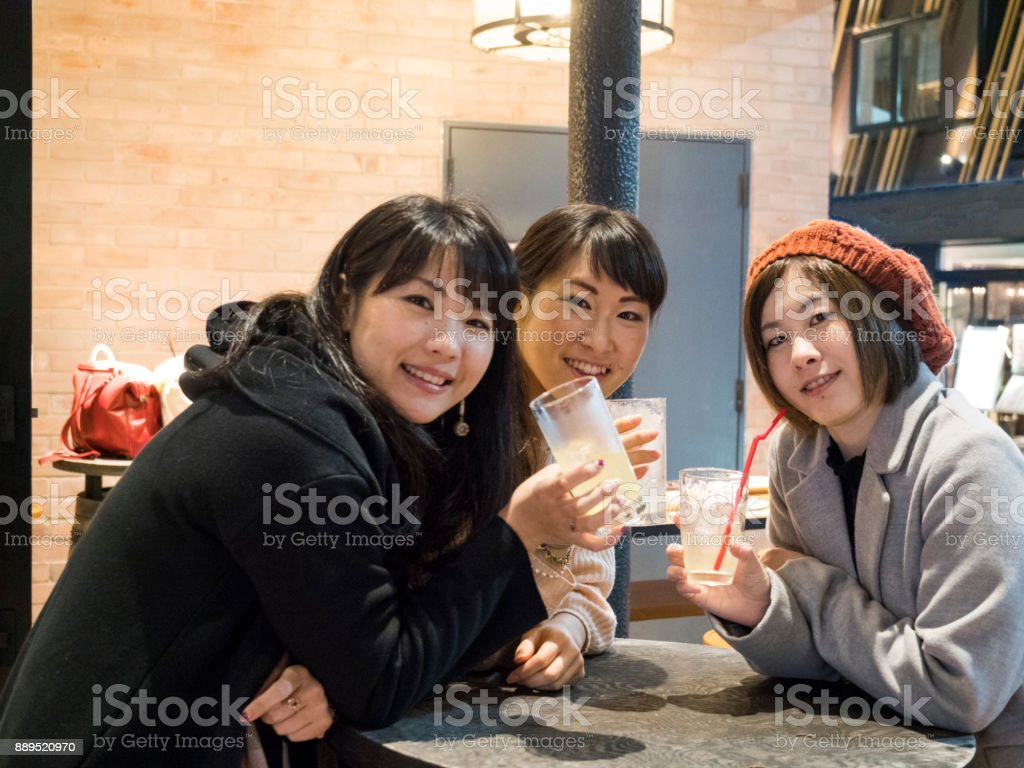 Japanese young ladies drinking after work. stock photo