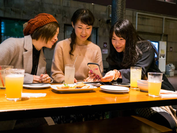 Japanese young ladies enjoy eating a dinner. stock photo