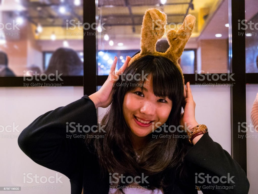Japanese young lady at the christmas party. stock photo