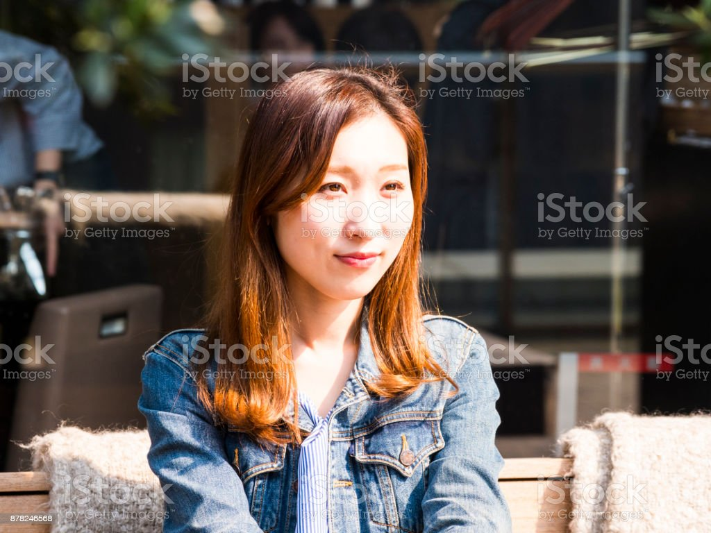 Japanese young lady waiting for her friends. stock photo