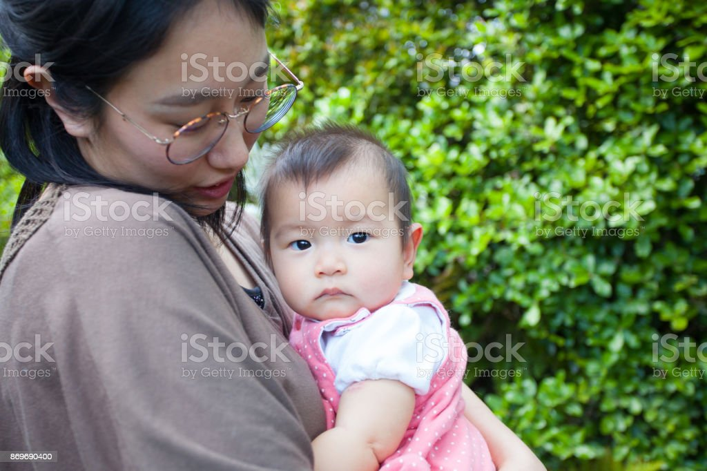 Japanese young mother and baby girl stock photo